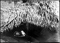 Frank Moon lying underneath some stalactites, Buchan Caves, Victoria - part of a mixed selection of lantern slides and negatives from John Flynn's teaching days in Gippsland, and early AIM (Australian Inland Mission) - (9780956241).jpg