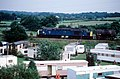 Freight train passes the Caravan Park Nr Moore - geograph.org.uk - 775684.jpg