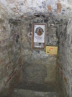 Chair of Saint Hilary, in the cell in which the saint used to pray. The chair was used by devotees of his cult to cure backache. Galeata Sant Ellero Scranno Cripta.JPG