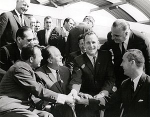 James McDivitt - McDivitt (1st from right) and Ed White (3rd from right) shake hands with Yuri Gagarin (1st from left) at the 1965 Paris Air Show