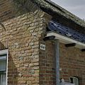 Gevel met huisnummer en detail metselwerk - Hoogkerk - 20375511 - RCE.jpg