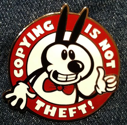 """Copying is not theft!"" badge with a character resembling Mickey Mouse in reference to the ""in popular culture"" rationale behind the Sonny Bono Copyright Term Extension Act of 1998"