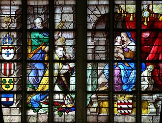 Lambert van Noort - Detail of Glass 13 in the Janskerk, Gouda with a portrait of the donor Petrus van Zuyren on the left.