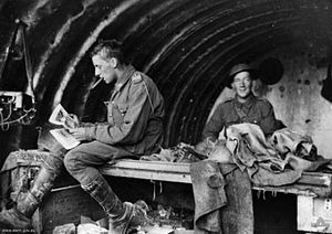 Thomas Baker (aviator) - Gunners Baker and Harrison of the 16th Battery relax in a dugout c. 1916
