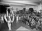 Gymnasts performing to crowd in hall (3928477970).jpg
