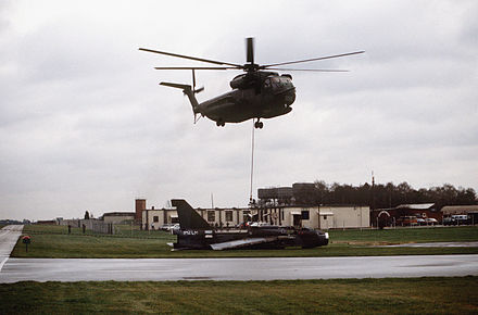 A USAF Sikorsky HH-53C helicopter of the 67th Aerospace Rescue and Recovery Squadron lifts a Lightning at RAF Woodbridge, Suffolk, 18 December 1987 - English Electric Lightning