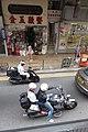 HK Tram tour view 德輔道西 Des Voeux Road West Sai Ying Pun shop n motorbike riders October 2017 IX1.jpg