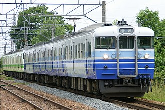 Hakushin Line - 115 series EMU bound for Niigata approaching Toyosaka Station, May 2008