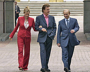 Vladmir Putin (right) walking around the Kreml...
