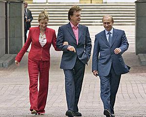 Vladmir Putin (right) walking around the Kreml...