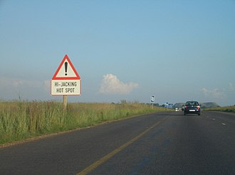 Carjacking - A sign in South Africa warning drivers
