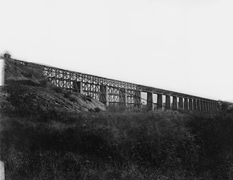 Battle of High Bridge - High Bridge over the Appomattox River near Farmville, Virginia. Photographed in 1865 by Timothy H. O'Sullivan during repairs following its burning during the war. The trestles on the left were burned by retreating Confederate troops.