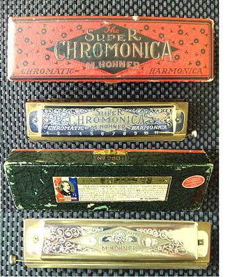 "Hohner - Hohner ""Super Chromonica""; case marked ""No.260 1/2"" (model); images top-to-bottom show the case top, harmonica top, case bottom, and harmonica bottom/obverse."