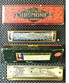 Hohner Super Chromonica (harmonica) and case.JPG