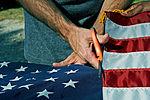 Honoring a symbol, Team Seymour holds flag retiring ceremony 140614-F-OB680-046.jpg