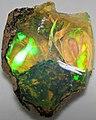 Hydrophane opal (precious opal) immersed in water (Tertiary; Ethiopia) 4 (32711405695).jpg