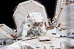 ISS-59 EVA-1 (o) Anne McClain outside the Quest airlock.jpg