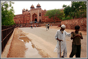 Blind old man walking past Fatehpur Sikri.