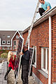 Installing solar power panels in Vleuten, Holland.jpg