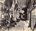 Interior of a house in the Sakar Bag, Junagadh, showing a long corridor adorned with pictures and furnishings.jpg