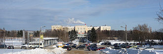 """Fryazino - In the center, in the background, the main building of RPC """"Istok"""". Left - one-story station building """"Fryazino-Passenger"""", which goes to the left oa railway line to Moscow. Behind it - snow-covered frozen pond on the Lyuboseyevka River"""