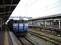 JRE 115 N-36 Kumoha 115-1522 at Yoshida Station.jpg