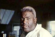An aging black man in semi-profile