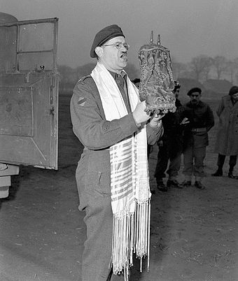 Captain Samuel Cass, a rabbi, conducting the first prayer service celebrated on German territory by Jewish personnel of the First Canadian Army near Cleve, Germany, 18 March 1945 Jewish Canadian soldiers during WWII.jpg
