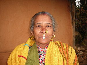Thami - A Thami woman in Ilam District wearing Jhamke Bulaki, a typical Nepali ornament on her nose.