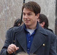 John Barrowman as Captain Jack Harkness at Cardiff Bay (cropped).jpg