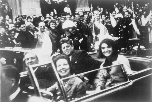 The Kennedys and the Connallys in the presidential limousine moments before the assassination in Dallas John F. Kennedy motorcade, Dallas crop.png