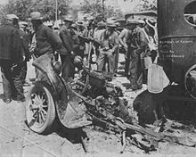 the almost destroyed chassis of Kehoe's Ford pickup truck, surrounded by onlookers