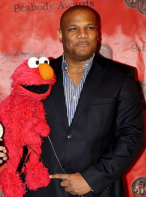 Kevin Clash - Clash with Elmo at the Peabody awards in 2010.