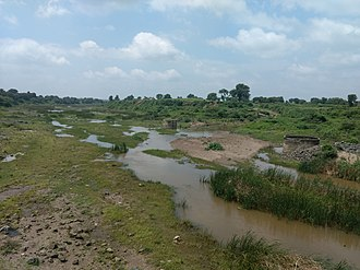 Purna River (tributary of Godavari) - Purna river right after Khadakpurna Dam.  The dam can be seen in distant.