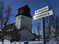 Kirkenes Church with roadsigns in Norwegian and Russian.jpg