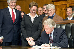 77th Oregon Legislative Assembly - Oregon Governor John Kitzhaber signs House Bill 2800 in the 2013 regular session, as House Speaker Tina Kotek and others look on. The bill authorizes funding for the Columbia River Crossing.