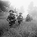 Led by their piper, men of 7th Seaforth Highlanders, 15th (Scottish) Division advance during Operation 'Epsom' in Normandy, 26 June 1944. B6000.jpg