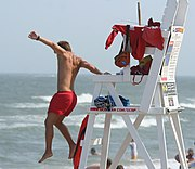 A lifeguard jumping into action.