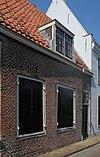 foto van Laag huis met rechte gootlijst