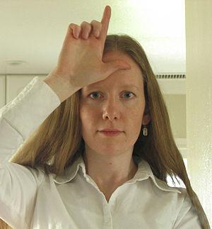 Loser (hand gesture) - Woman making the loser gesture