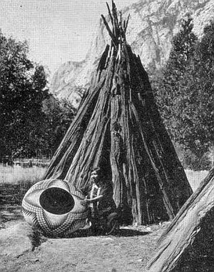 Basket weaving - Artist Lucy Telles and large basket, in Yosemite National Park, 1933