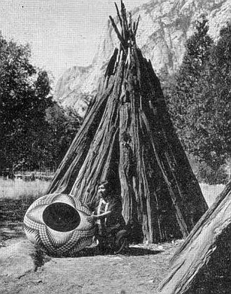 Kucadikadi - Lucy Telles in front of her tomogani  with her largest basket, Yosemite National Park, 1933