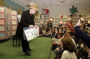 Lynne Cheney giving a public reading from her book America: A Patriotic Primer to the students of Vincenza Elementary School in Vicenza, Italy. (2004)