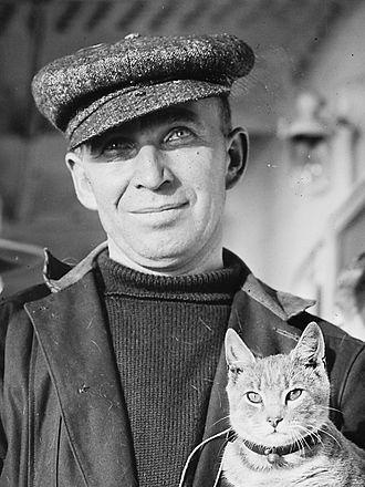 "Ship's cat - M. Vaniman and ""Kiddo""."