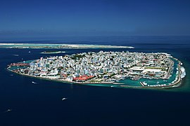 Aerial view of the whole of Malé proper on the eponymous island as seen from the southwest