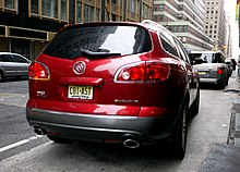 Rear view of a metallic red Buick Enclave in New York