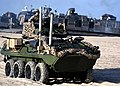Marines unload assault reconnaissance vehicles from a landing craft. (26935809008).jpg
