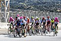 Mark Cavendish leads a large group of riders up the Rahal Straight at Laguna Seca (28889213338).jpg