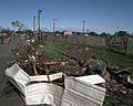 Members of the 552nd Air combat Wing clear debris from the base parameter following an F-5 tornado that devastated a good portion of Oklahoma City, Oklahoma, just barely missing Tinker AFB, Oklahoma DF-SD-00-03253.jpg