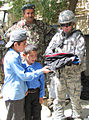 Members of the Afghan Air Corps provide much needed school supplies to a school about 2 miles north of Kabul International Airport (4677750549).jpg